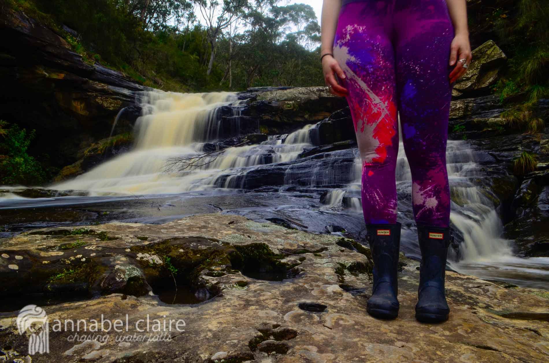 Chasing Waterfalls wearing Nike leggings and Hunter Boots at Swallow Cave Falls